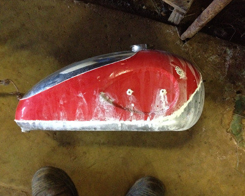 Motorcycle tank to be cleaned ready to have dents knocked out